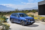 Picture of a 2018 BMW X3 M40i in Phytonic Blue Metallic from a front right three-quarter perspective