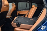 Picture of a 2018 BMW X3 M40i's Rear Seats Folded in Cognac