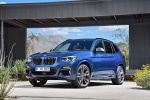 Picture of a 2018 BMW X3 M40i in Phytonic Blue Metallic from a front left three-quarter perspective