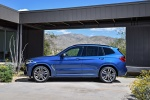 Picture of a 2018 BMW X3 M40i in Phytonic Blue Metallic from a side perspective