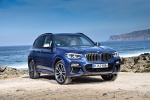 Picture of a 2019 BMW X3 M40i in Phytonic Blue Metallic from a front right perspective
