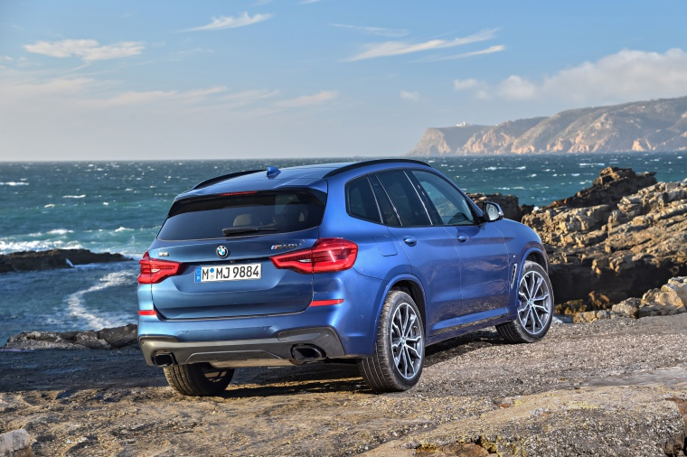 Picture of a 2020 BMW X3 M40i in Phytonic Blue Metallic from a rear right three-quarter perspective