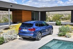 Picture of a 2020 BMW X3 M40i in Phytonic Blue Metallic from a rear right perspective