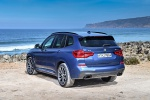 Picture of a 2020 BMW X3 M40i in Phytonic Blue Metallic from a rear left perspective