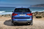 Picture of a 2020 BMW X3 M40i in Phytonic Blue Metallic from a rear perspective