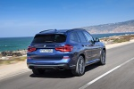 Picture of a driving 2020 BMW X3 M40i in Phytonic Blue Metallic from a rear right perspective
