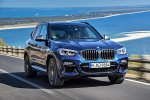 Picture of a driving 2020 BMW X3 M40i in Phytonic Blue Metallic from a front right perspective