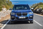 Picture of a driving 2020 BMW X3 M40i in Phytonic Blue Metallic from a frontal perspective