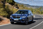 Picture of a driving 2020 BMW X3 M40i in Phytonic Blue Metallic from a front left perspective