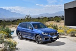 Picture of a 2020 BMW X3 M40i in Phytonic Blue Metallic from a front right three-quarter perspective