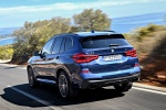 Picture of a driving 2020 BMW X3 M40i in Phytonic Blue Metallic from a rear left perspective