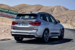 Picture of a driving 2020 BMW X3 M Competition in Donington Gray Metallic from a rear right perspective