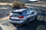 Picture of a driving 2020 BMW X3 M Competition in Donington Gray Metallic from a rear right three-quarter perspective