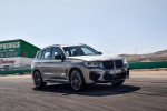 Picture of a driving 2020 BMW X3 M Competition in Donington Gray Metallic from a front right three-quarter perspective