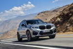 Picture of a driving 2020 BMW X3 M Competition in Donington Gray Metallic from a front right perspective