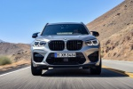Picture of a driving 2020 BMW X3 M Competition in Donington Gray Metallic from a frontal perspective