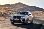 Picture of a driving 2020 BMW X3 M Competition in Donington Gray Metallic from a front left perspective