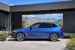Picture of a 2020 BMW X3 M40i in Phytonic Blue Metallic from a side perspective