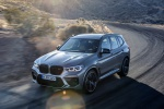 Picture of a driving 2020 BMW X3 M Competition in Donington Gray Metallic from a front left three-quarter perspective