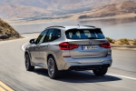 Picture of a driving 2020 BMW X3 M Competition in Donington Gray Metallic from a rear left perspective