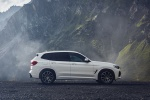 Picture of a 2020 BMW X3 xDrive30e PHEV AWD in Alpine White from a side perspective