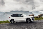 Picture of a driving 2020 BMW X3 xDrive30e PHEV AWD in Alpine White from a front right three-quarter perspective