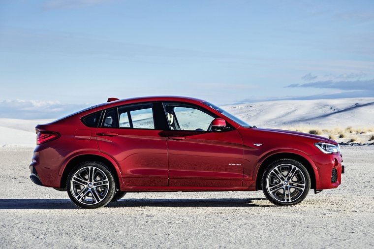 2017 BMW X4 in Melbourne Red Metallic from a side view