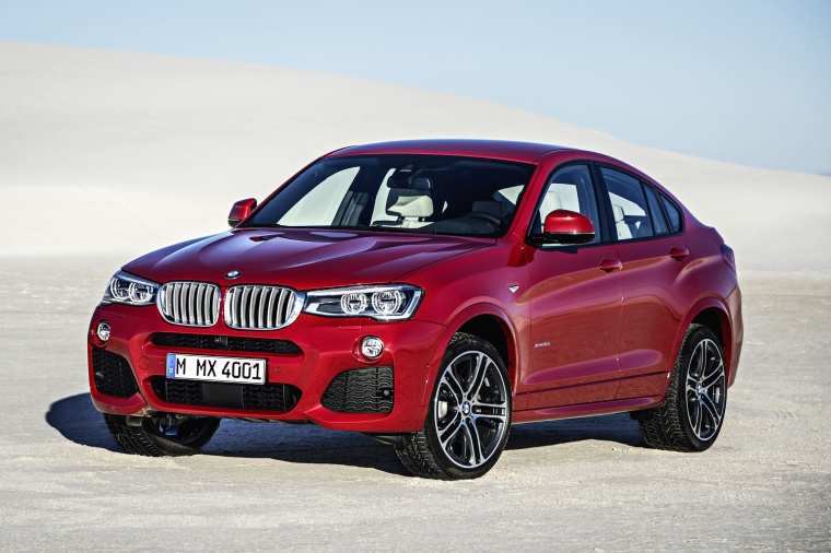 2017 BMW X4 in Melbourne Red Metallic from a front left three-quarter view