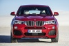 2017 BMW X4 in Melbourne Red Metallic from a frontal view