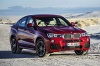 2017 BMW X4 in Melbourne Red Metallic from a front right view
