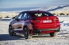 2017 BMW X4 in Melbourne Red Metallic from a rear left view