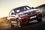 2017 BMW X4 in Melbourne Red Metallic - Driving Front Right Three-quarter View