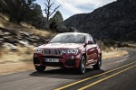 2017 BMW X4 in Melbourne Red Metallic - Driving Front Left View