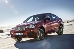 2017 BMW X4 in Melbourne Red Metallic - Driving Front Left Three-quarter View