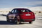 2017 BMW X4 in Melbourne Red Metallic - Driving Rear Left View
