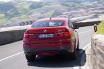 2017 BMW X4 in Melbourne Red Metallic - Driving Rear View
