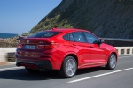 2017 BMW X4 in Melbourne Red Metallic - Driving Rear Right Three-quarter View