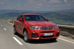2017 BMW X4 in Melbourne Red Metallic - Driving Front Right View