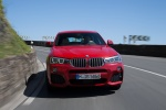 2017 BMW X4 in Melbourne Red Metallic - Driving Frontal View
