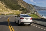2017 BMW X4 M40i in Mineral White Metallic - Driving Rear View
