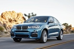 2017 BMW X4 M40i in Long Beach Blue Metallic - Driving Front Left Three-quarter View