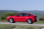2018 BMW X4 in Melbourne Red Metallic - Driving Left Side View