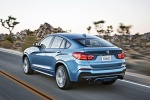 2018 BMW X4 M40i in Long Beach Blue Metallic - Driving Rear Left Three-quarter View