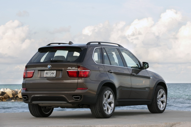 2011 BMW X5 xDrive50i in Sparkling Bronze Metallic from a rear right view