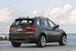 2011 BMW X5 xDrive50i in Sparkling Bronze Metallic - Static Rear Right View