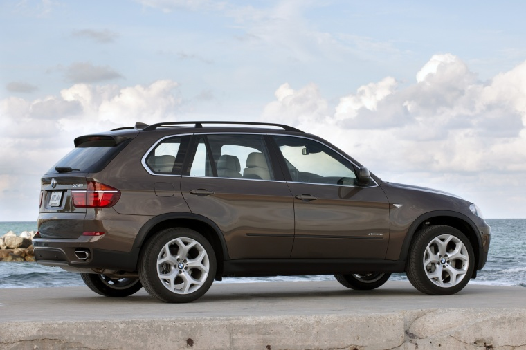 2012 BMW X5 xDrive50i in Sparkling Bronze Metallic from a rear right three-quarter view