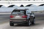 2013 BMW X5 xDrive50i in Sparkling Bronze Metallic - Driving Rear Right View