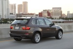 2013 BMW X5 xDrive50i in Sparkling Bronze Metallic - Driving Rear Right Three-quarter View