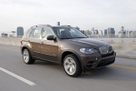 2013 BMW X5 xDrive50i in Sparkling Bronze Metallic - Driving Front Right Three-quarter View