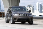 2013 BMW X5 xDrive50i in Sparkling Bronze Metallic - Driving Front Right View